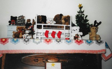 Doll furniture from my childhood. Tattered quilt made by Grandma Ruby Neal. At bottom, Christmas writing done by my mother, Doris Neal, in first grade.